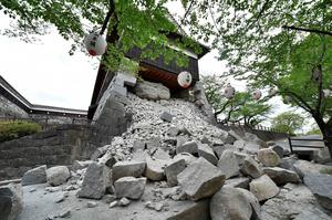 This picture shows a collapsed stone wall of the Kumamoto Castle after an earthquake in Kumamoto on April 16, 2016. A powerful earthquake hit southern Japan early on April 16, authorities said, sending panicked residents out of their homes in a region where nerves were already frayed by a swarm of strong shaking. / AFP PHOTO / KAZUHIRO NOGIKAZUHIRO NOGI/AFP/Getty Images