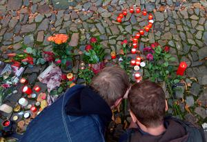 Men place candles to a question mark in front of the French embassy on November 14, 2015 in Prague a day after deadly attacks in Paris. The string of coordinated attacks in and around Paris late November 13, 2015 left more than 120 people dead, in the worst such violence in France's history. AFP PHOTO / MICHAL CIZEKMICHAL CIZEK/AFP/Getty Images