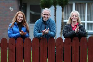 Belfast Telegraph - Portadown - Clap for the NHS -  2 April 2020  Former football manager Harry Fay with his wife Geraldine and daughter Amy.