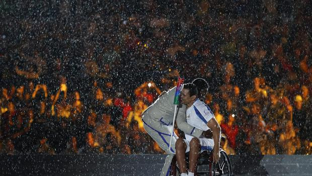 RIO DE JANEIRO, BRAZIL - SEPTEMBER 07:  Clodoaldo Silva is embraced by singer Seu Jorge after lighting the cauldron during the Opening Ceremony of the Rio 2016 Paralympic Games at Maracana Stadium on September 7, 2016 in Rio de Janeiro, Brazil.  (Photo by Buda Mendes/Getty Images) *** BESTPIX ***