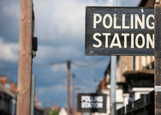 A sign is pictured outside a polling station in Kingston-Upon-Hull, northern England, on June 8, 2017 as Britain votes in the general election. AFP/Getty Images