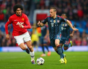 MANCHESTER, ENGLAND - APRIL 01:  Marouane Fellaini of Manchester United tracks Franck Ribery of Bayern Muenchen during the UEFA Champions League Quarter Final first leg match between Manchester United and FC Bayern Muenchen at Old Trafford on April 1, 2014 in Manchester, England.  (Photo by Alex Livesey/Getty Images)