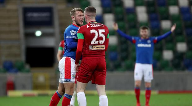 Linfield's Kirk Millar with Cliftonville's Aaron Donnelly during Tuesday nights BetMcLean League Cup game at Windsor Park, Belfast. Photo by William Cherry/Presseye