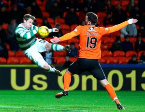 DUNDEE, SCOTLAND - JANUARY 15 Kris Commons of Celtic scores a spectacular volleyed goal from distance in the second half during the Ladbrokes Scottish Premiership match between Celtic FC and Dundee United FC at Tannadice Park on January 15, 2016 in Dundee, Scotland. (Photo by Mark Runnacles/Getty Images)