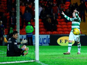 DUNDEE, SCOTLAND - JANUARY 15 Kris Commons of Celtic celebrates with his team mates Leigh Griffiths and Mikael Lustig after scoring a spectacular volleyed goal from distance in the second half during the Ladbrokes Scottish Premiership match between Celtic FC and Dundee United FC at Tannadice Park on January 15, 2016 in Dundee, Scotland. (Photo by Mark Runnacles/Getty Images)