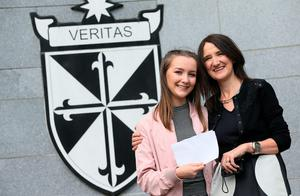 Ellen Reid, who achieved 3 A*s and an A with her mother and geography teacher at the school Mary Reid, at Dominican College in Belfast after receiving her A level results. Brian Lawless/PA Wire