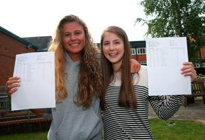 Ellen Pauley (left) and Rachel Philpott who both achieved four A*s at Sullivan Upper School, Holywood, after receiving her A level results. Brian Lawless/PA Wire