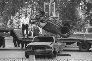 Cars removed from the scene of the Hyde Park car bomb in which four soldiers died.