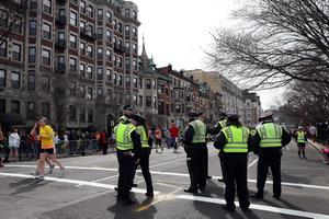 BOSTON, MA - APRIL 15:  Boston Police guard an area near Kenmore Square after two bombs exploded during the 117th Boston Marathon on April 15, 2013 in Boston, Massachusetts. Two people are confirmed dead and at least 23 injured after two explosions went off near the finish line to the marathon.  (Photo by Alex Trautwig/Getty Images)