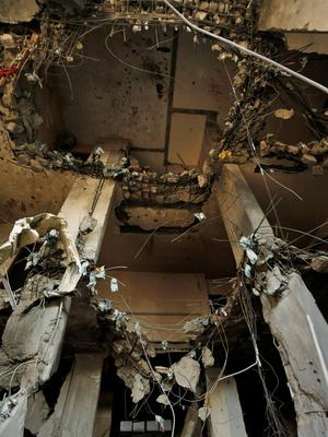 Damages are seen of the building belonging to the Yazjhi family which was destroyed by an Israeli strike in Gaza City, Wednesday, July 23, 2014. (AP Photo/Lefteris Pitarakis)