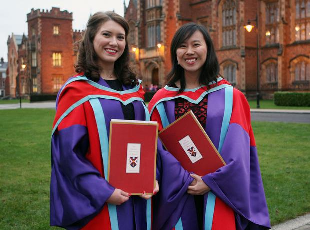 Mandatory Credit - Picture by Freddie Parkinson/Press Eye © Thursday 8th December 2016 Graduations take place at Queens University in Belfast. Patricia McCann from Belfast and Samanatha Lin from Sydney Australia.