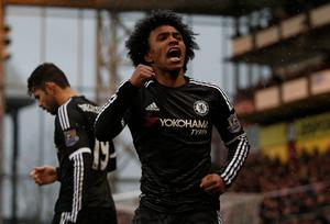 Chelsea's Brazilian midfielder Willian celebrates scoring his team's second goal during the English Premier League football match between Crystal Palace and Chelsea at Selhurst Park in south London on January 3, 2016. AFP PHOTO / ADRIAN DENNIS  RESTRICTED TO EDITORIAL USE. NO USE WITH UNAUTHORIZED AUDIO, VIDEO, DATA, FIXTURE LISTS, CLUB/LEAGUE LOGOS OR 'LIVE' SERVICES. ONLINE IN-MATCH USE LIMITED TO 75 IMAGES, NO VIDEO EMULATION. NO USE IN BETTING, GAMES OR SINGLE CLUB/LEAGUE/PLAYER PUBLICATIONS.ADRIAN DENNIS/AFP/Getty Images