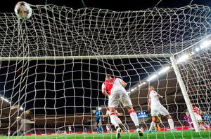 Monaco's Brazilian defender Wallace (R) looks at the ball shot by Arsenal's Olivier Giroud going into his team's net during the UEFA Champions League football match Monaco vs Arsenal, on March 17, 2015 at Louis II stadium in Monaco. AFP PHOTO / BERTRAND LANGLOISBERTRAND LANGLOIS/AFP/Getty Images
