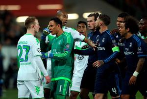 Real Madrid's Costa Rican goalkeeper Keylor Navas (2ndL) argues with Wolfsburg's midfielder Maximilian Arnold (L) during the UEFA Champions League quarter-final, first-leg football match between VfL Wolfsburg and Real Madrid on April 6, 2016 in Wolfsburg, northern Germany.  / AFP PHOTO / RONNY HARTMANNRONNY HARTMANN/AFP/Getty Images