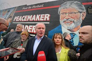 BELFAST, NORTHERN IRELAND - MAY 03:  Sinn Fein's Martin McGuinness and Martina Anderson address a crowd gathered on the Falls Road in support of Gerry Adams on May 3, 2014 in Belfast, Northern Ireland. The Sinn Fein leader has spent a third night in police custody in connection with the 1972 murder of mother-of-10 Jean McConville.  (Photo by Jeff J Mitchell/Getty Images)