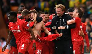 File photo dated 23-01-2016 of Liverpool's Adam Lallana (20) celebrates with his team-mates and manager Jurgen Klopp after scoring his side's fifth goal during the Barclays Premier League match at Carrow Road, Norwich. PA