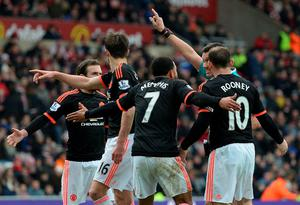 Manchester United's Dutch midfielder Memphis Depay (3R) and teammates call for a handball after Depay struck a shot towards goal during the English Premier League football match between Sunderland and Manchester United at the Stadium of Light in Sunderland, northeast England on February 13, 2016.  Sunderland won the match 2-1. / AFP / OLI SCARFF /