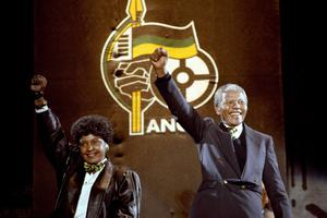 File photo dated 17/04/1990 of Nelson Mandela, with wife Winnie, giving the famous clench-fist saltue of the African National Congress to tens of thousands of fans who gathered to hear him at a concert in his honour at Wembley Stadium last night. Former South African leader Nelson Mandela has died at the age of 95, the country's president, Jacob Zuma, said tonight. PRESS ASSOCIATION Photo. Issue date: Thursday December 5, 2013. See PA story DEATH Mandela. Photo credit should read PA Wire
