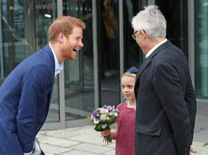 Harry is greeted at the Orestad Gymnasium (Jonathan Brady/PA)