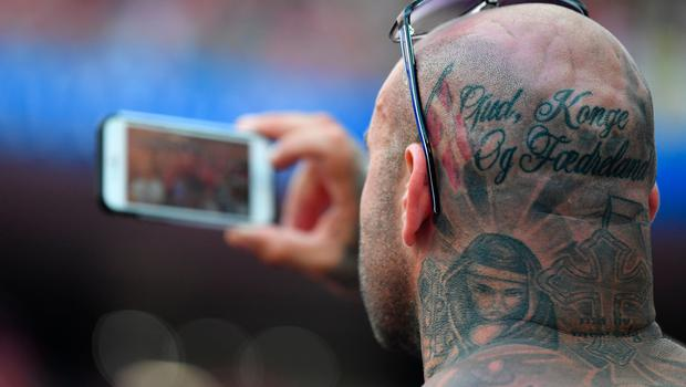 MOSCOW, RUSSIA - JUNE 26:  A Denmark fan takes pictures during the 2018 FIFA World Cup Russia group C match between Denmark and France at Luzhniki Stadium on June 26, 2018 in Moscow, Russia.  (Photo by Dan Mullan/Getty Images)