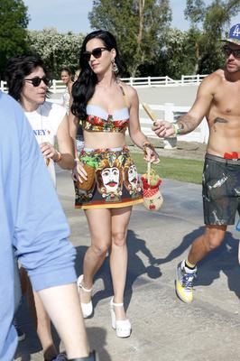 PALM SPRINGS, CA - APRIL 13:  Singer Katy Perry attends the FIJI Water At Lacoste L!VE Coachella Desert Pool Party on April 13, 2013 in Palm Springs, California.  (Photo by Imeh Akpanudosen/Getty Images for FIJI)