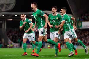 Northern Ireland's Jonny Evans (centre) celebrates scoring his side's first goal of the game with team-mates during the UEFA Euro 2020 Qualifying, Group C match at Windsor Park, Belfast. PRESS ASSOCIATION Photo. Picture date: Sunday March 24, 2019. See PA story SOCCER N Ireland. Photo credit should read: Brian Lawless/PA Wire. RESTRICTIONS: Use subject to restrictions. Editorial use only. No commercial use.