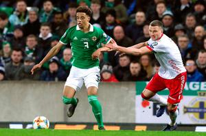 Northern Ireland's Jamal Lewis (left) in action during the UEFA Euro 2020 Qualifying, Group C match at Windsor Park, Belfast. PRESS ASSOCIATION Photo. Picture date: Sunday March 24, 2019. See PA story SOCCER N Ireland. Photo credit should read: Brian Lawless/PA Wire. RESTRICTIONS: Use subject to restrictions. Editorial use only. No commercial use.