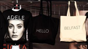 BELFAST, NORTHERN IRELAND - FEBRUARY 29:  Adele merchandise promoting her opening Belfast show can be seen in a stall stationed outside the SSE Arena on February 29, 2016 in Belfast, Northern Ireland. Adele's highly anticipated world tour begins this evening with some news outlets reporting tickets changing hands for thousands of pounds. Adele made history recently by becoming the most succesful solo artist in a single year at the Brit Awards by winning four trophies.   (Photo by Charles McQuillan/Getty Images)