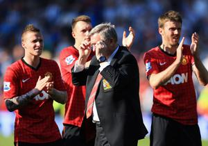 WEST BROMWICH, ENGLAND - MAY 19:  Manchester United manager Sir Alex Ferguson is applauded by players after his 1,500th and final match in charge of the club following the Barclays Premier League match between West Bromwich Albion and Manchester United at The Hawthorns on May 19, 2013 in West Bromwich, England.  (Photo by Richard Heathcote/Getty Images)