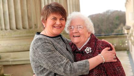 DUP leader Arlene Foster is hugged by her mother Georgina Kelly after becoming First Minister at Parliament Buildings, Stormont