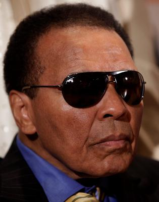 """This file photo taken on May 24, 2011 shows World Heavyweight Boxing Champion Muhammad Ali at a news conference at the National Press Club in Washington. Boxing icon Muhammad Ali died on Friday, June 3, a family spokesman said in a statement. """"After a 32-year battle with Parkinsons disease, Muhammad Ali has passed away at the age of 74,"""" spokesman Bob Gunnell said.  / AFP PHOTO / YURI GRIPASYURI GRIPAS/AFP/Getty Images"""