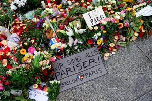 "A message reads "" We are all Parisians - Berlin loves Paris "" amount flowers and candles on the ground outside the French embassy in Berlin, on November 16, 2015 three days after deadly attacks in Paris. The string of coordinated attacks in and around Paris late November 13, 2015 left at  least 129 people dead, in the worst such violence in France's history.  AFP PHOTO / JOHN MACDOUGALLJOHN MACDOUGALL/AFP/Getty Images"