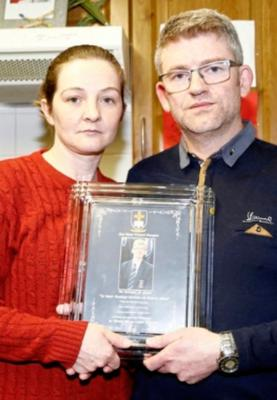 Maria and James with a picture of Morgan