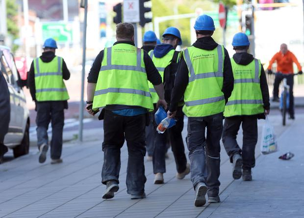 Construction workers on their way to the new University of Ulster site in Belfast. Pic Stephen Davison Pacemaker