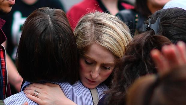 Retail staff hug each other after being evacuated from the Arndale Centre shopping mall in Manchester, northwest England on May 23