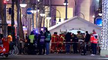 Rescue workers gather with stretchers outside a tent in the area after a lorry truck ploughed through a Christmas market on December 19, 2016 in Berlin, Germany. (Photo by Sean Gallup/Getty Images)