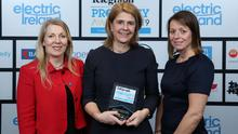 Clare McAllister (left), NI Residential Manager for Electric Ireland, and Sarah Little (right), INM Publishing Director NI, present Beth Robinson of Templeton Robinson with the Property Personality of the Year award