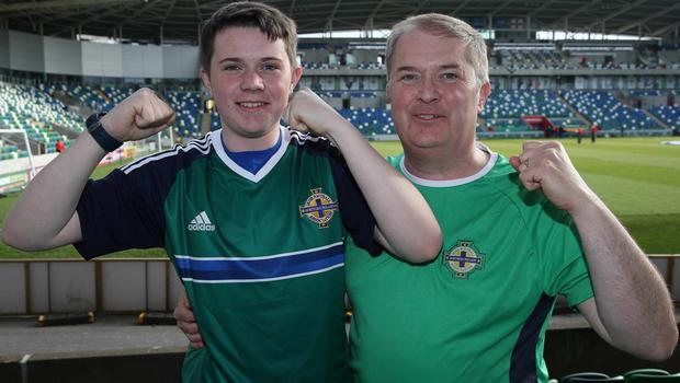 @Press Eye Ltd Northern Ireland- 27th May 2016 Mandatory Credit -Brian Little/Presseye George Emerson with his son Cameron aged 14 from Bangor  watching Northern Ireland     and Belarus      during Friday night's Vauxhall Friendly International match  at the National Football Stadium at Windsor Park. Picture by Brian Little/Presseye