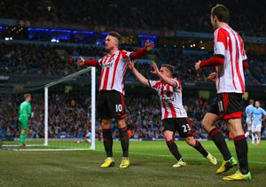 MANCHESTER, ENGLAND - APRIL 16:  Connor Wickham of Sunderland celebrates scoring their second goal with Emanuele Giaccherini of Sunderland  during the Barclays Premier League match between Manchester City and Sunderland at Etihad Stadium on April 16, 2014 in Manchester, England.  (Photo by Alex Livesey/Getty Images)
