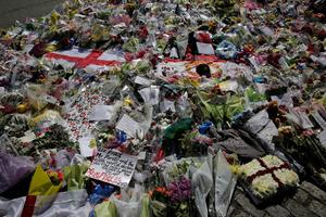 LONDON, ENGLAND - MAY 26:  Floral tributes outside the Royal Artillery Barracks, close to where Drummer Lee Rigby of the 2nd Battalion the Royal Regiment of Fusiliers was killed