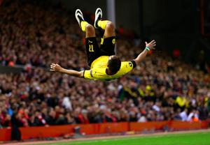 LIVERPOOL, ENGLAND - APRIL 14:  Pierre-Emerick Aubameyang of Borussia Dortmund celebrates scoring his team's second goal during the UEFA Europa League quarter final, second leg match between Liverpool and Borussia Dortmund at Anfield on April 14, 2016 in Liverpool, United Kingdom.  (Photo by Clive Brunskill/Getty Images)