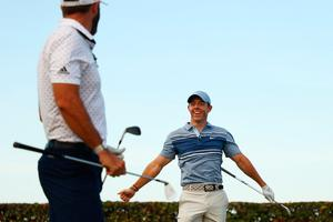 JUNO BEACH, FLORIDA - MAY 17: Rory McIlroy of the American Nurses Foundation team and Dustin Johnson of the American Nurses Foundation team react on the 17th tee after winning the closest to the pin playoff against Rickie Fowler of the CDC Foundation team and Matthew Wolff of the CDC Foundation team during the TaylorMade Driving Relieve Supported By UnitedHealth Group on May 17, 2020 at Seminole Golf Club in Juno Beach, Florida. (Photo by Mike Ehrmann/Getty Images)