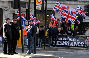 Demonstrators waving flags outside the Old Bailey in London ahead of the sentencing of Michael Adebolajo and Michael Adebowale who were convicted of the murder of Fusilier Lee Rigby.