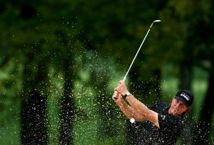 LOUISVILLE, KY - AUGUST 10:  Phil Mickelson of the United States hits a bunker shot on the eighth hole during the final round of the 96th PGA Championship at Valhalla Golf Club on August 10, 2014 in Louisville, Kentucky.  (Photo by Jeff Gross/Getty Images)