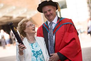 John Tommy Joe Farrell, received the honorary degree of Doctor of the University (DUniv) for distinguished services to sport at the University. John is pictured with his mum Rosaline. (Photo: Nigel McDowell/Ulster University)