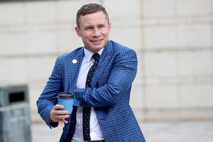 Former world champion boxer Carl Frampton  arrives at Belfast High Court on Wednesday. Picture by Stephen Davison/Pacemaker