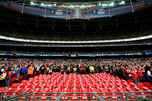 96 empty seats are draped with Liverpool scarves to mark the 25th anniversary of the Hillsborough disaster prior to  the FA Cup Semi-Final match between Wigan Athletic and Arsenal at Wembley Stadium on April 12, 2014 in London, England.  (Photo by Shaun Botterill/Getty Images)