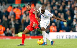 """Liverpool's Georginio Wijnaldum (left) and Leeds United's Souleymane Doukara (right) battle for the ball during the EFL Cup, Quarter Final match at Anfield, Liverpool. PRESS ASSOCIATION Photo. Picture date: Tuesday November 29, 2016. See PA story SOCCER Liverpool. Photo credit should read: Martin Rickett/PA Wire. RESTRICTIONS: EDITORIAL USE ONLY No use with unauthorised audio, video, data, fixture lists, club/league logos or """"live"""" services. Online in-match use limited to 75 images, no video emulation. No use in betting, games or single club/league/player publications."""