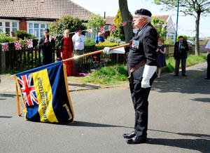 RETRANSMISSION - adding name. Local Royal British Legion branch chairman, Eric Howden, 75, lowers his standard in respect during a two minute silence in Redcar, North Yorkshire, to mark the 75th anniversary of VE Day. PA Photo. Picture date: Friday May 8, 2020. See PA story MEMORIAL VE . Photo credit should read: Owen Humphreys/PA Wire