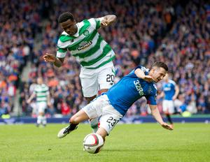 Celtic's Dedryck Boyata (left) and Rangers' Jason Holt (right) battle for the ball during the William Hill Scottish Cup semi-final match at Hampden Park, Glasgow. PRESS ASSOCIATION Photo. Picture date: Sunday April 17, 2016. See PA story SOCCER Rangers. Photo credit should read: Jeff Holmes/PA Wire. EDITORIAL USE ONLY